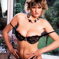 Mature MILF Debbie Q pridefully showcases her superb knockers in black panties