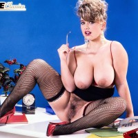 Aged MILF Tracy West sets her massive fun bags loose in fishnet hosiery and high heeled shoes