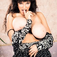 Older XXX movie star Big-titted BriAnna sets her enormous funbags free and her shaven gash as well