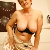 older ginger-haired girlfriend whips out enormous all natural breasts after flaunting no panty upskirt