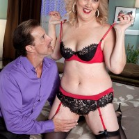 Mature wife with blond hair Rebecca Williams seduces her spouse in lingerie and hosiery