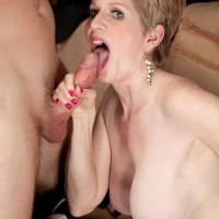 Aged dame Sindee Dix is undressed naked before fellating her younger paramour