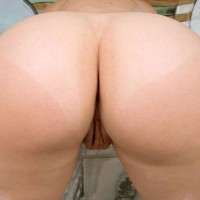 MILF model Leenuh Kai showing off foxy ass in g-string panties before releasing coochie