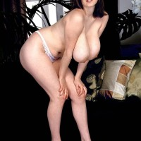 MILF XXX film star Nicole Peters extracting immense funbags from milky brassiere in lace undies