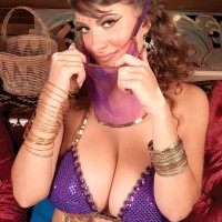 MILF adult film star Valory Irene posing invitingly fully clothed in harem female uniform