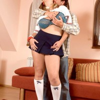 MILF Terry Nova has her large boobies freed by stud mate from bra in a mini-skirt and knee socks