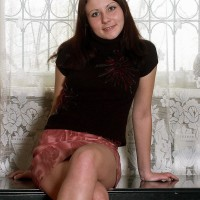 Nude first-timer brunette solo girl flaunting fur covered muff in bare feet on bench