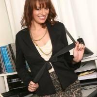 Filthy experienced boss lady undressing down to tights and high-heeled shoes in her office place
