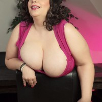 Plus sized dark-haired solo model Mia Sweetie undressing down to her melon-holder and undies