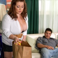 Plus sized girl Hillary Hooterz giving a blow job while coated in crop juice