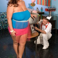 Over weight chick Rose Valentina masturbating while licking cotton candy