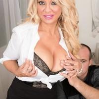 Older light-haired boss woman Bella Dea unsheathing immense titties before giving BLOW-JOB in office place