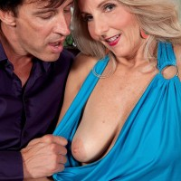 Elderly yellow-haired lady Chery Leigh exposes her knockers in tan nylons for her husband