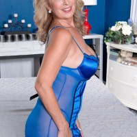 Senior blonde broad Laura Layne baring humungous butt in nylons and high-heeled shoes for junior boy