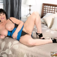 Elderly brown-haired lady Elektra letting large tits loose from dress in high heels