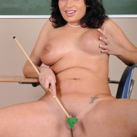 Senior brown-haired professor whipping out huge boobs and hairless muff in heels