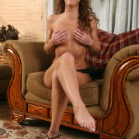 Older dark haired doll with excellent legs slurping her own toes after disrobing