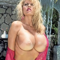 Experienced pornstar Kimberly Kupps lets out her enormous melons from bikini top by the pool