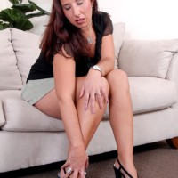 Senior solo model posing nude after peeling off microskirt and high-heels
