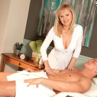 Over 50 platinum-blonde MILF Arjana seducing younger dude in white stockings and garters
