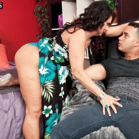 Over 50 dark-haired Azure Dee providing younger stud hand job before doggy banging