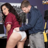 Over Fifty black-haired cleaning woman Victoria Versaci tit fucking and slurping penis in work environment