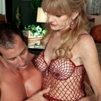 Over Fifty MILF Denise Day letting gigantic hooters free from lingerie for nip slurping