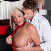 Over Fifty MILF Sally D'Angelo having immense melons freed from dress by younger man