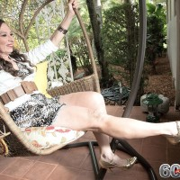 Over 60 MILF Mona gives a blowjob after seducing a junior guy in her backyard