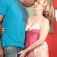 Smallish grandmother Miranda Torri has her hard nips blown by her younger ebony lover