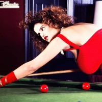 XXX star Nilli Willis exposes her immense knockers on pool table in red gloves and sundress