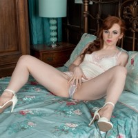 Red-haired solo girl Vivi St. Claire exposing unshaven ginger cunny from seductive lingerie