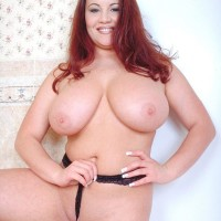 Ginger-haired MILF Annie Swanson wets her huge boobs in the bath during solo act