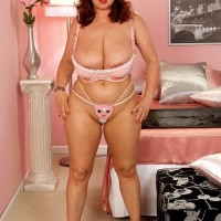 Red-haired fatty Virgin Brady struts in her bra and panty ensemble and pinkish stilettos