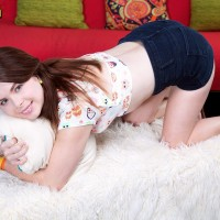 Red-haired teenager Jennifer Matthews strips naked on her bed to feast turning Eighteen