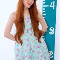 Redheaded nubile XXX starlet Dolly Small unleashing diminutive knockers in lovely panties
