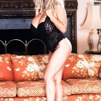 Irresistible sandy-haired Alexis Enjoy releases her monster-sized fun bags from black lingerie