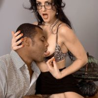Inviting dark haired grandmother Lake Russell entices a blows a younger black man on a sofa