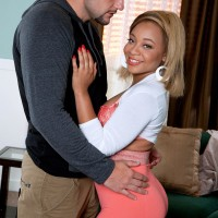 Enticing ebony chick Mandy Rivers displaying enticing ass in pinkish spandex pants and heels