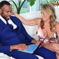 Beautiful mature lady Torri Lee tempts a black man by extracting her giant melons from her dress