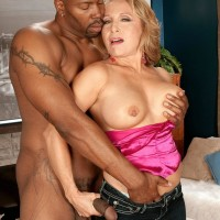 Tempting aged doll Luna Azul seduces a younger black stud in satin lingerie and denim jeans