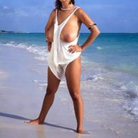 Provocative MILF Devon Daniels frees her immense boobs while suspending at the beach