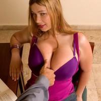 Wondrous ginger-haired MILF Terry Nova letting out immense boobs to tempt sex in denim miniskirt