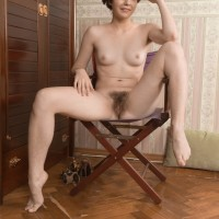 Short haired first-timer in high-heels Aria doffing shorts to expose furry muff
