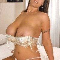 Solo female Eva Notty looses her immense fun bags from her brassiere while readying for a rubdown