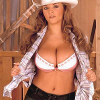 Solo chick Ines Cudna letting big boobies loose in jeans and cowgirl hat in barn