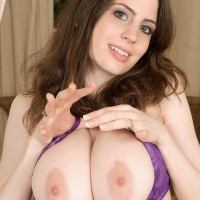 Solo female Lillian Faye looses her huge boobs from her brassiere before taunting her nips