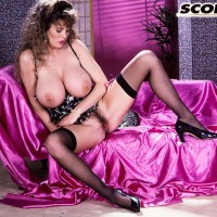 Solo female Lisa Kelly cradles a monster-sized titty in hose paired with garters