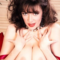 Solo model Diana Wynn flashes off her huge all-natural knockers in black stockings