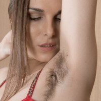 Solo model Donatella flashes off her hairy armpits and cunt in nude strutting debut